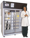 Lab technician in front of refrigerator